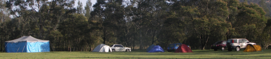 [Paddock with cars and tents]